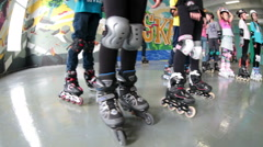 Human legs are wearing in roller skates and with full protective equipment. Kids Stock Footage