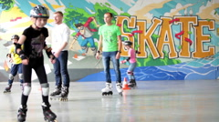 Two adult instructors are in skating rink. Playground in Russia Stock Footage