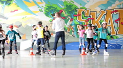 Children training is in indoor rollerskate playground. Group of kids  Stock Footage