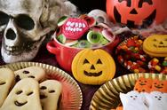 Cookies and candies on an ornamented table for Halloween Stock Photos