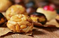 Closeup of some roasted chestnuts and some panellets, typical snack in All Sa Stock Photos