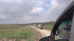 Ayn Issa, Syria, Stuck in traffic ,SDF - YPJ,YPG Rojava scene Stock Footage