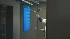 Painting process by spray gun for decoration work piece Stock Footage
