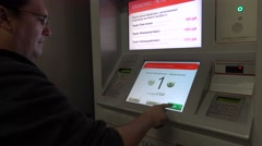 Man buy train ticket in vending maschine Stock Footage