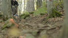Mountain bike downhill on the trail in the woods of super slow motion Stock Footage