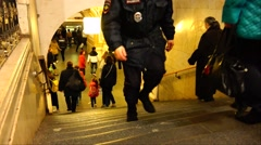A police officer keeps order in the Moscow metro. Stock Footage