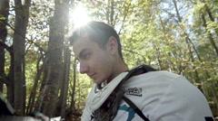 Racer mountain bike downhill put my helmet in slow motion Stock Footage