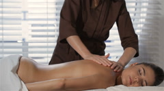 Masseur massages female client at the beauty salon Stock Footage