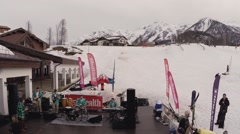 Quadrocopter shoot people dance in cafe at mountains. Ski resort. Music band Stock Footage