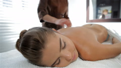 Massage specialist begins to massage female client Stock Footage