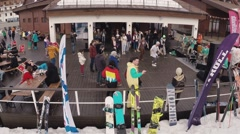 Quadrocopter shoot people break dance in cafe at mountains. Ski resort. Snow Stock Footage