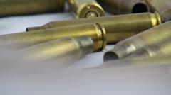 Bullets cartridges pan slow moviment on white background Stock Footage