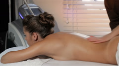 Masseur turns on the massage machine Stock Footage