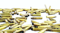 Bullets falling on white background Stock Footage