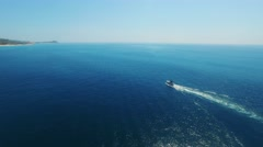 Aerial drone flying tracking yacht in Los Cabos Mexico Bay Stock Footage