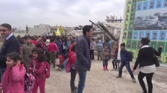Syria, Kobani - February, 2016: People photographing before photos of martyrs Stock Footage