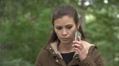 Stressed young woman talking cell phone Stock Footage