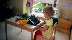 Child playing with tablet. Computer addict girl Stock Footage