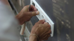Man installing electrical sockets Stock Footage