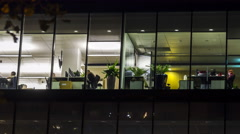 Creative office workers in the end of working day time lapse Stock Footage