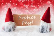 Red Christmassy Gnomes With Card, Frohes Fest Means Merry Christmas Stock Photos