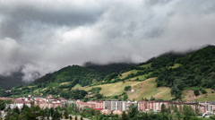 Timelapse of clouds and city with mountains Asturias, timelapse Stock Footage