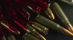 Bloody Bullets from Gun Violence on a Table Stock Footage