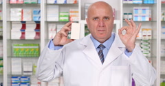 Chemist Present Best Vitamins with Ok Hand Gesture in a Drugstore Advertisement Stock Footage