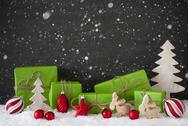 Red And Green Christmas Decoration, Black Cement Wall, Snow, Snowflakes Stock Photos