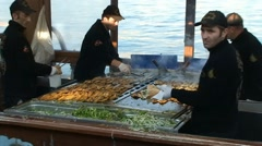 Floating fish kebab cafe kitchen on the boat in Istanbul Stock Footage