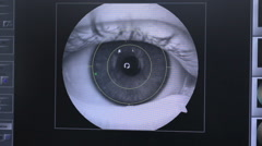 Retina security scanning. Eye, cornea checking for access to restricted area Stock Footage