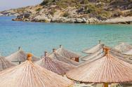 Sunshades on the beach, beautiful colors of the sea,summer travel vacation. Stock Photos