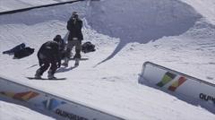 Snowboarder slide on rail, but falling. Ski resort. Sunny day. Extreme stunts Stock Footage