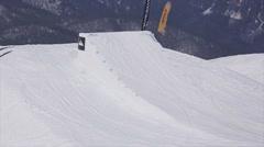 SOCHI, RUSSIA - APRIL 2, 2016: Skier jump from springboard, make full flip in Stock Footage
