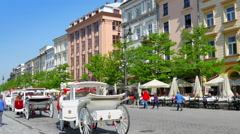 4K Krakow Horse Carriages and European Tourist Square, Summer Time Stock Footage