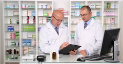 Pharmacy Store Employees Working in Collaboration Check Available Drugs Stock Stock Footage