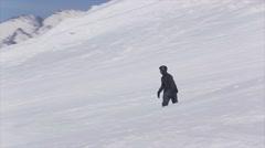 SOCHI, RUSSIA - APRIL 2, 2016: Snowboarder ride on slope. Ski resort. Landscape Stock Footage
