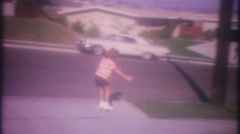 Young girl on rollerskates runs into telephone pole,3718 vintage film home movie Stock Footage