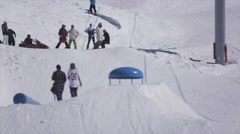 SOCHI, RUSSIA - APRIL 2, 2016: Snowboarder jump over springboard. Ski resort Stock Footage