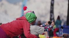 SOCHI, RUSSIA - APRIL 2, 2016: Young couple take selfie in encamp. Ski resort Stock Footage