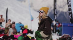 SOCHI, RUSSIA - APRIL 2, 2016: Young girl in sunglasses relax in encamp. Ski Stock Footage