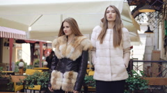 Fashionable models posing to camera in fur coat in shopping center 4K Stock Footage