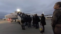 People climb the ladder into the plane, international airport Vnukov Stock Footage