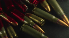 Bloody Bullets from Gun Violence on a Surface Stock Footage