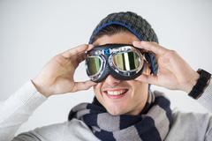 Man in winter clothing wearing aviator goggles Stock Photos