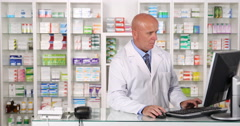 Apothecary Job in Pharmacy Store Using Computer Accessing Drug Stock Database Stock Footage