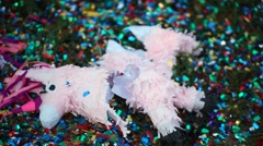 Broken pinata in the form of a horse lying on the grass Stock Footage