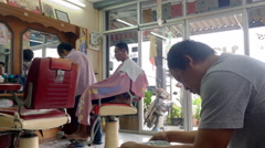 Classic style of Barber haircut shop in local country of Thailand , Editorial Stock Footage