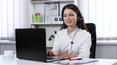 Girl working in the call center and communicates with customers through Stock Footage