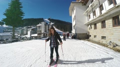 Young women learning to ski at Pamporovo ski center Stock Footage